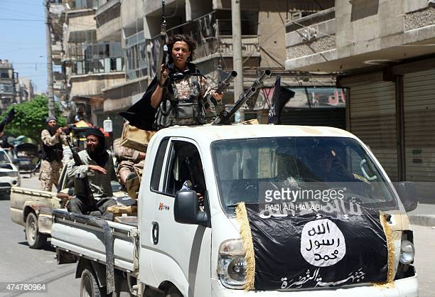 Fighters from AlQaeda's Syrian affiliate AlNusra Front drive in armed vehicles in the northern Syrian city of Aleppo as they head to a frontline on...