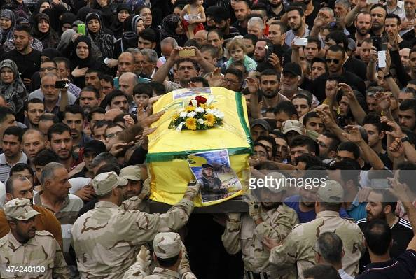 Fighters from Lebanon's Shiite movement Hezbollah carry the coffin of a fellow militant Ali Sakr during his funeral procession on May 21 2015 in a...
