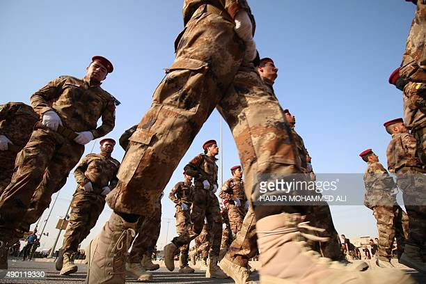 Fighters from the Abbas battalion of the Shiite Popular Mobilisation units march during a military parade in the southern Iraqi city of Basra on...