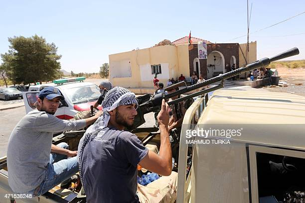 Fighters from the Fajr Libya an alliance of Islamistbacked militias hold a position during clashes with forces loyal to Libya's internationally...