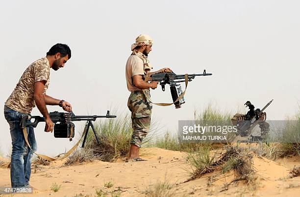 Fighters from the Fajr Libya militia load their weapons during clashes with forces loyal to Libya's internationally recognised government southwest...