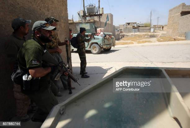 Fighters from the Hashed AlShaabi advance inside alNour neighbourhood in eastern Tal Afar the main remaining stronghold of the Islamic State group...
