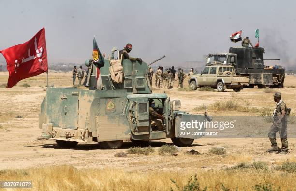 Fighters from the Hashed AlShaabi advance towards the town of Tal Afar west of Mosul after the Iraqi government announced the beginning of the...