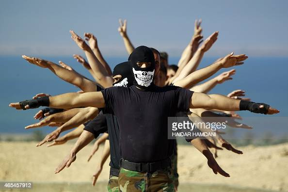 Fighters from the Iraqi Imam Ali Brigade take part in a training exercise in Iraq's central city of Najaf on March 7 ahead of joining the military...
