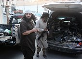 Fighters from the Islamic State group load a van with parts that they said was a US drone that crashed into a communications tower in Raqqa early on...