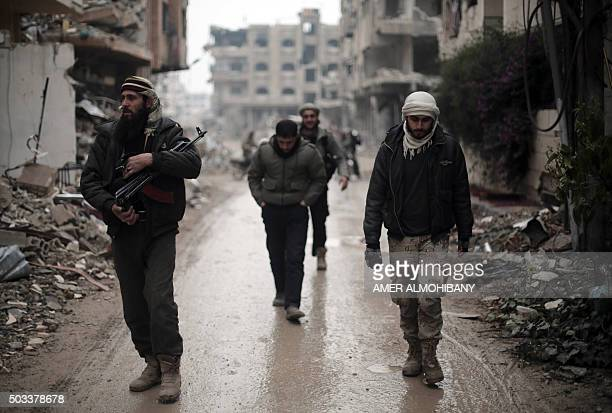 Fighters from the Jaish alIslam the foremost rebel group in Damascus province who fiercely opposed to both the regime and the Islamic State group...