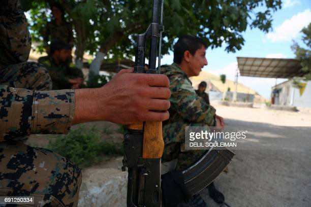Fighters from the Kurdish People's Protection Units line up during military exercises at a training facility in the northeastern Syrian Kurdish town...
