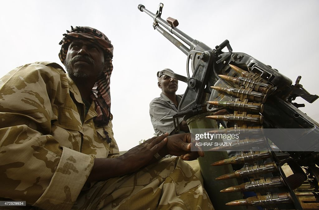Fighters from the Sudanese Rapid Support Forces sit on an armed vehicle in the city of Nyala in south Darfur on May 3 as they display weapons and...