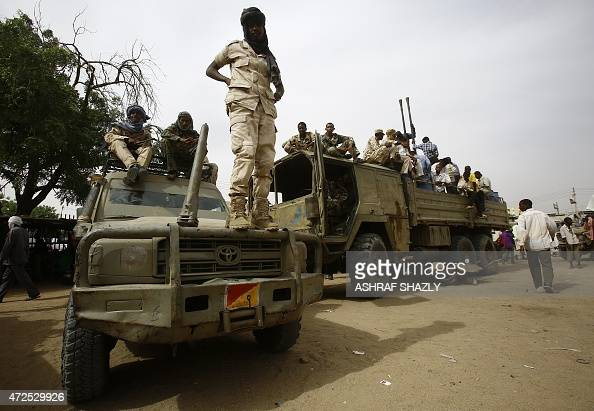 Fighters from the Sudanese Rapid Support Forces sit on armed vehicles in the city of Nyala in south Darfur on May 3 as they display weapons and...