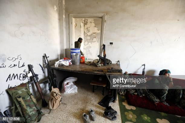 Fighters from the Women's Protection Units rest in abandoned building in Raqa's eastern alSanaa neighbourhood on the edge of the old city on August...