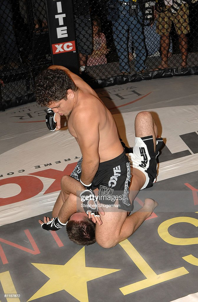 MMA fighters Jake Shields (bottom) and Nick Diaz demonstrate MMA fighting techniques at CBS's 'Elite XC Saturday Night Fights' Press Conference at CBS Radford Studios on May 19, 2008 in Studio City, California.