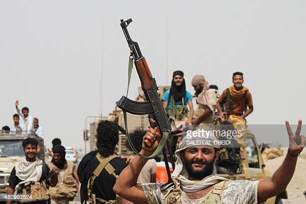Fighters loyal to exiled President Abedrabbo Mansour Hadi gather on a road on the outskirts of the southern Yemeni port city of Aden on August 3...
