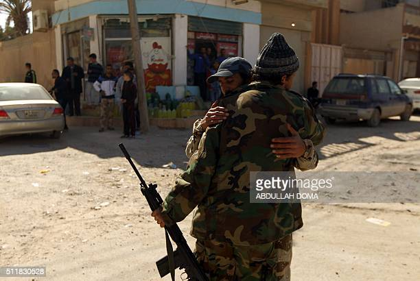 TOPSHOT Fighters loyal to Libya's internationally recognised government celebrate as they come close to seizing the centre of Libya's eastern coastal...