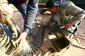 Fighters loyal to the Fajr Libya an alliance of Islamistbacked militias prepare a bullet belt on March 15 2015 in Libya's coastal city of Sirte which...