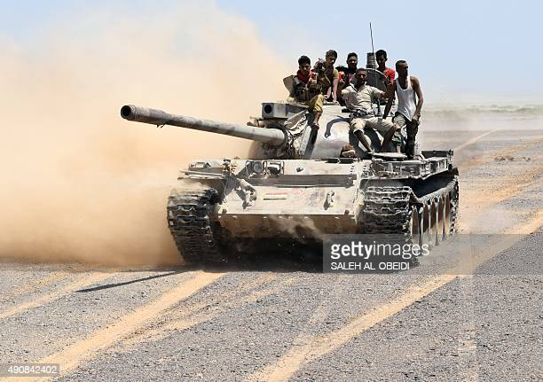 Fighters loyal to Yemeni President Abedrabbo Mansour Hadi drive a tank in the area of the strategic Bab alMandab Strait in the southern Yemeni...