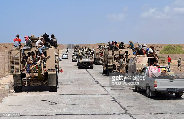 Fighters loyal to Yemeni President Abedrabbo Mansour Hadi drive in the area of the strategic Bab alMandab Strait in the southern Yemeni province of...