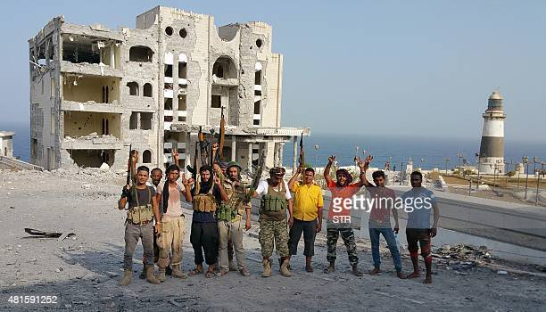 Fighters loyal to Yemen's exiled President Abedrabbo Mansour Hadi pose for a picture near the presidential palace following clashes in Aden's...