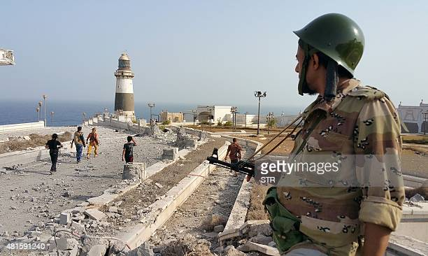 Fighters loyal to Yemen's exiled President Abedrabbo Mansour Hadi walk in the area of the presidential palace on July 22 2015 Yemeni progovernment...