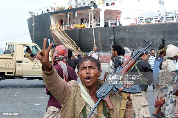 TOPSHOT Fighters loyal to Yemen's President Abedrabbo Mansour Hadi celebrate after they managed to secure completely and take control of the port of...