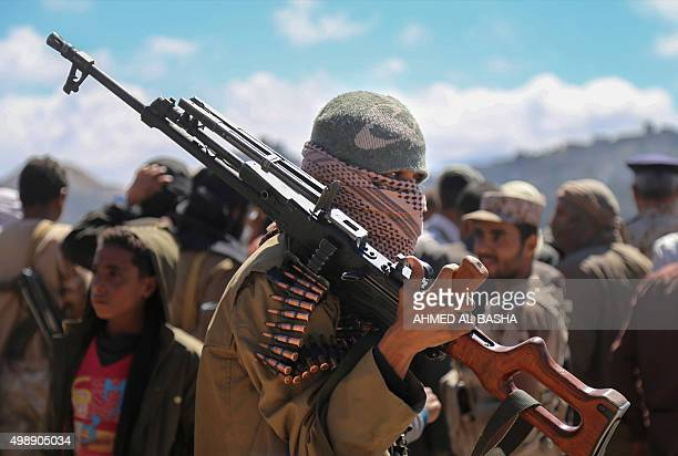 Fighters loyal to Yemen's President Abedrabbo Mansour Hadi stand guard at a military area in Taez's Misrakh District on November 26 2015 Government...
