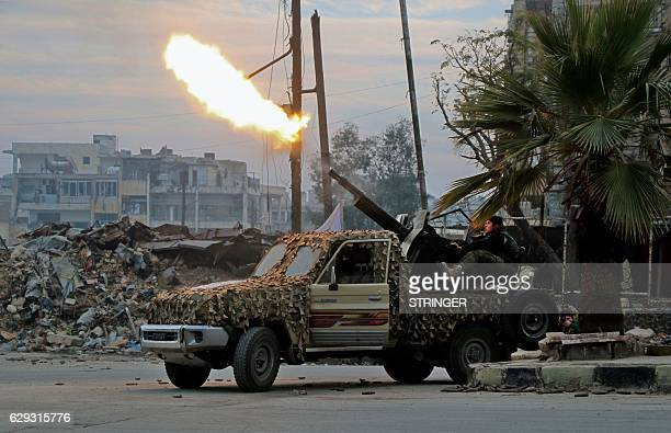TOPSHOT Fighters of the Free Syrian Army fire an antiaircraft weapon in Aleppo's rebelheld area of Mashhad on December 12 as they battle Syrian...