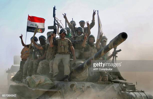 TOPSHOT Fighters of the Hashed AlShaabi advance towards the town of Tal Afar west of Mosul after the Iraqi government announced the beginning of the...