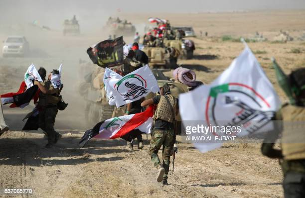 Fighters of the Hashed AlShaabi advance towards the town of Tal Afar west of Mosul after the Iraqi government announced the beginning of the...