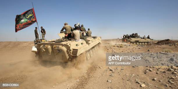 Fighters of the Hashed alShaabi paramilitaries are seen riding on infantryfighting vehicles during the advance towards villages between the northern...