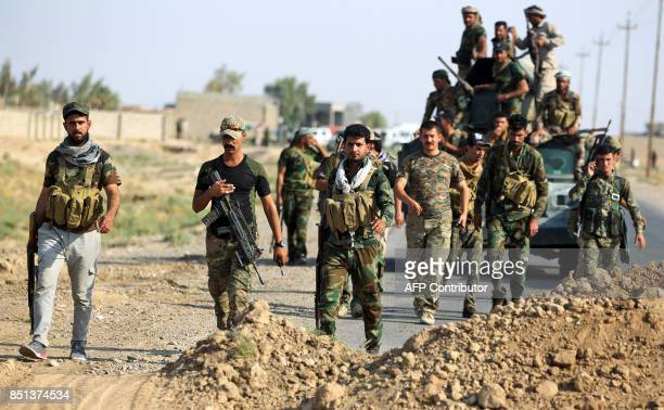 Fighters of the Hashed alShaabi paramilitaries prepare to advance towards the northern Iraqi town of Sharqat on September 22 2017 Iraqi forces...