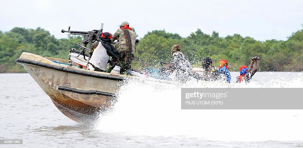 Fighters of the Movement for the Emancipation of the Niger Delta (MEND), speed away from the militia's creek camp in the Niger Delta on September 17, 2008. Armed Nigerian militants who have declared an 'oil war' on September 14, in response to what it said was an unprovoked attack by the army, claimed to have blown up a major pipeline in their latest attack on oil installations in the region. MEND, the most prominent of the groups operating in the creeks and swamps of the Niger Delta, said it blew up a pipeline it believes is operated by Royal Dutch Shell and Italy's Agip. The rebels moved in with speed boats, dynamite and hand grenades in their attack on the Orubiri flow station, the army said. MEND says it is fighting for local people to get a greater share of the huge oil revenues. Since MEND took up arms in early 2006, Nigeria's oil output has been cut by at least one quarter due to kidnappings and sabotage in the Delta. Hurricane Barbarossa is the code name MEND has given to its new offensive against foreign majors. 'I derive satisfaction in destruction of oil installations in the Niger Delta', said Boy Loaf, leader of the militants.