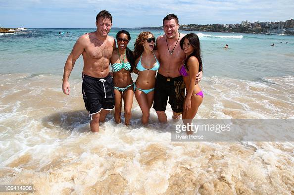 Fighters Stephan Bonnar and Matt Mitrione pose with Octagon Girls Chandella Powell Brittney Palmer and Arianny Celeste at Bondi Beach on February 25...