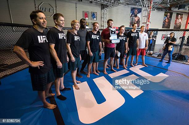UFC fighters Uriah Hall Forrest Griffin Kevin Lee and Evan Dunham pose for a picture with NASCAR drivers after a workout at the TUF Gym on September...