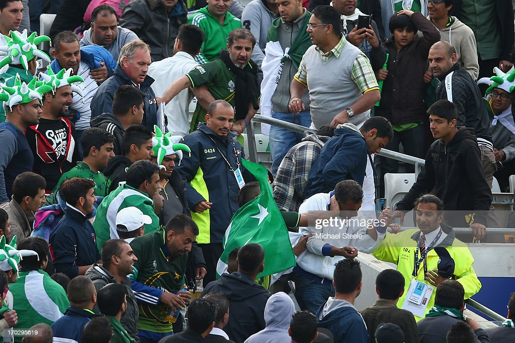 Fighting breaks out amongst supporters of Pakistan in the stands during the ICC Champions Trophy Group B match between Pakistan and South Africa at Edgbaston on June 10, 2013 in Birmingham, England.
