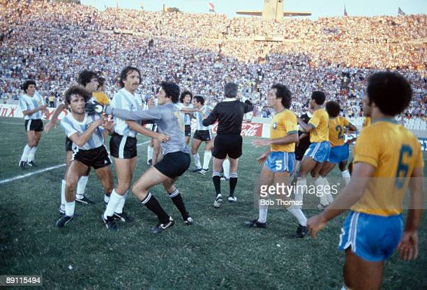 Fighting breaks out between the Argentinian and Brazilian players at the end of their match at the Estadio Centenario during the Copa De Oro...