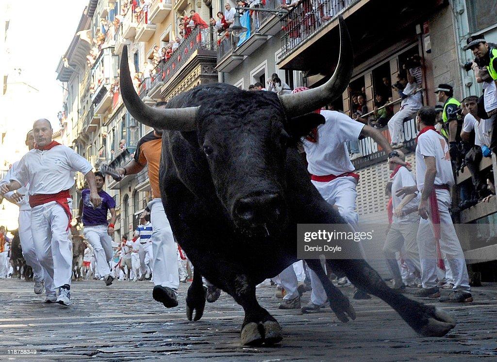 A fighting bull goes around Estafeta corner on the sixth day of the San Fermin runningofthebulls on July 11 2011 in Pamplona Spain Pamplona's famous...