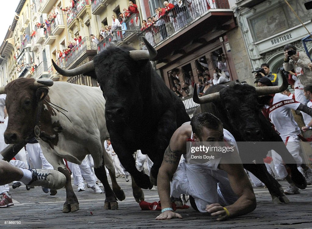 A fighting bull leaps over a fallen runner at the Mercaderes curve during the third San Fermin running of the bulls on July 9, 2008 in Pamplona, Spain. Fighting bulls are run through the historic heart of Pamplona for eight days in this fiesta made famous by the 1926 novel of U.S. writer Ernest Hemmingway called 'The Sun Also Rises'.
