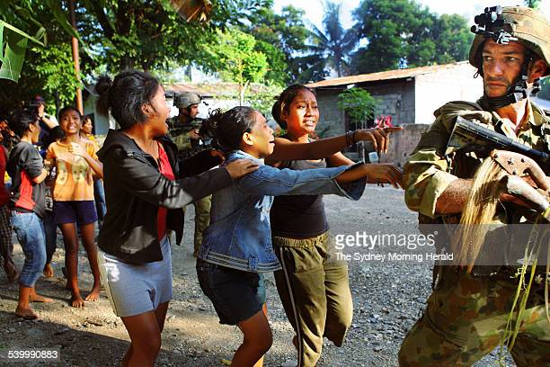Fighting continued in East Timor around the streets of Dili and mountain villages while small groups of Australian SAS and Commandos rescued locals...