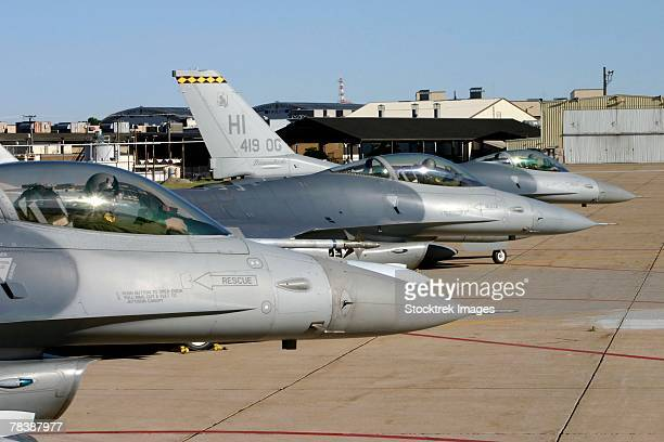 F-16 Fighting Falcons taxi for departure.