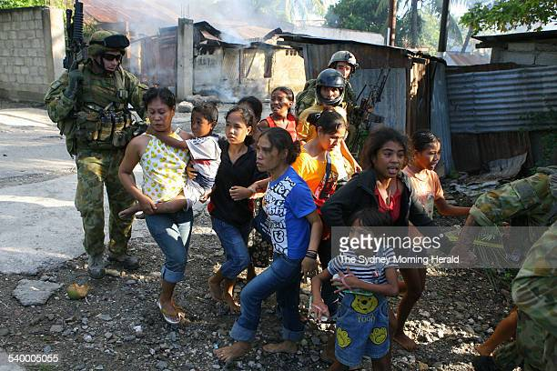Fighting in East Timor around the streets of Dili and mountain villages while small groups of Australian SAS and Commandos rescued locals caught up...