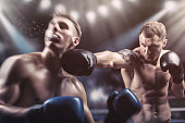Two professional boxers fighting in the ring