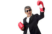 The Asian senior businessman with boxing gloves.