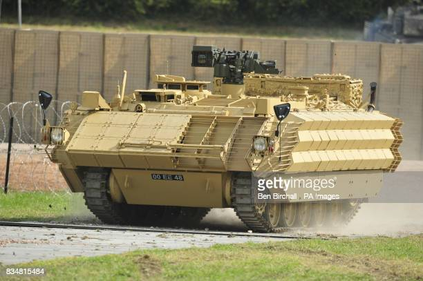 Fighting Vehicle with heavily upgraded body armour in the form of heavy duty metal grids that are covered in sheet steel causing antitank weapons to...