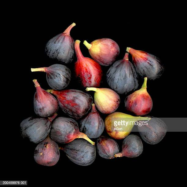 Figs against black background, close-up