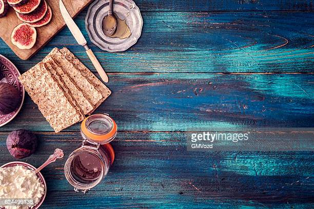 Figs, Crispbread, Cottage Cheese and Sweet Honey on Wooden Background