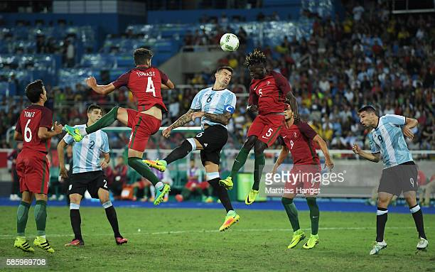 Figueiredo Tobias and Ie Edgar of Portugal battle for the ball with Victor Cuesta of Argentina during the Men's Group D first round match between...