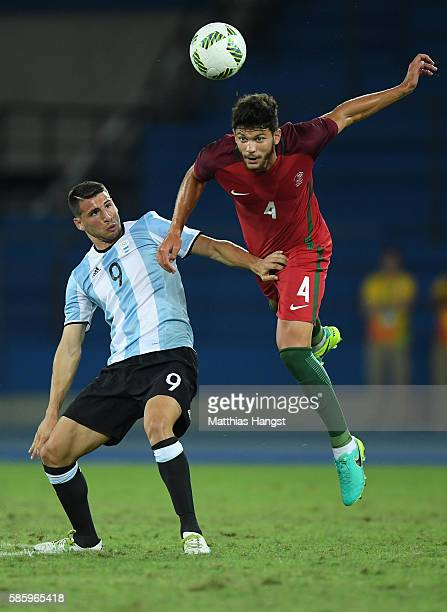 Figueiredo Tobias of Portugal makes heads the ball over Jonathan Calleri of Argentina during the Men's Group D first round match between Portugal and...