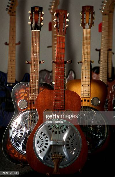 FIGuitarthree0303RL–Huntington Beach–Three Dobro guitars from different eras left to right are a 1974 stencil finished model 60 a model 27G circa...