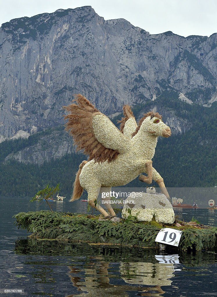 A Figur made of daffodils is presented at the boat parade in Bad Aussee at Ausseerland, Austria, on May 29, 2016, as part of the 57st Daffodil Festival that takes place in Bad Aussee and Altausee from 26 to 29 May. / AFP / APA / BARBARA GINDL / Austria OUT