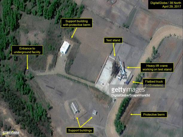 Figure 1 A heavylift crane and flatbed truck are seen at the test stand at Sinpo Mandatory credit for all images DigitalGlobe/38 North via Getty...