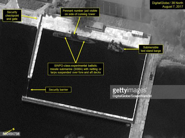 Figure 1 Netting or tarps suspended over SINPOclass SSBA in the secure boat basin Mandatory credit for all images DigitalGlobe/38 North via Getty...